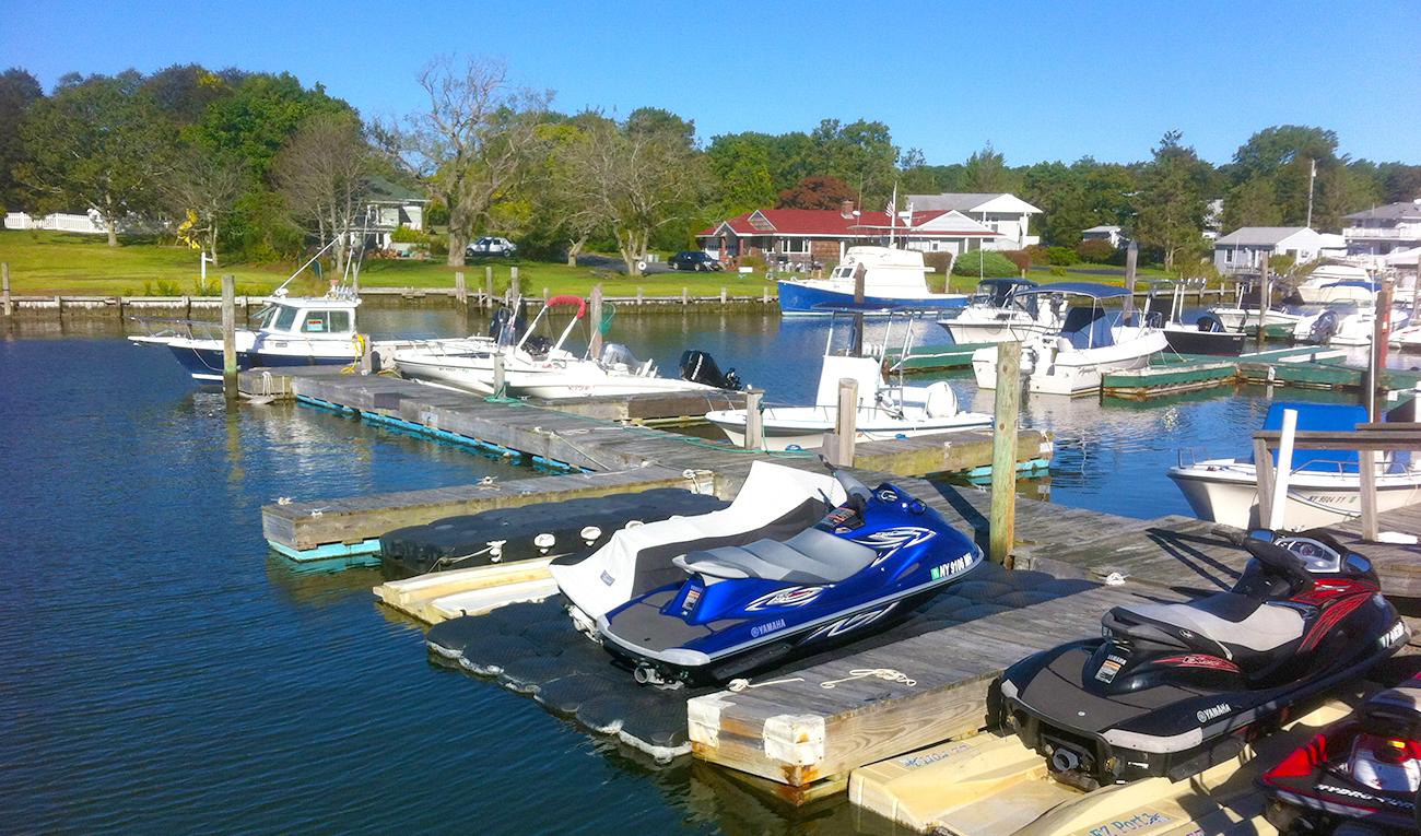 Boat and personal watercaft repair repair services at Ponquoge Power. 30 slip Marina.